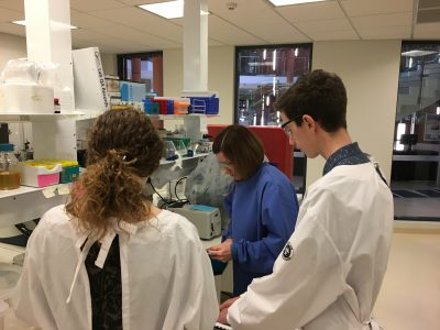 Austin Beck and Antonia Murphy receive instruction from Senior Microbiologist Dr. Michelle Bull.
